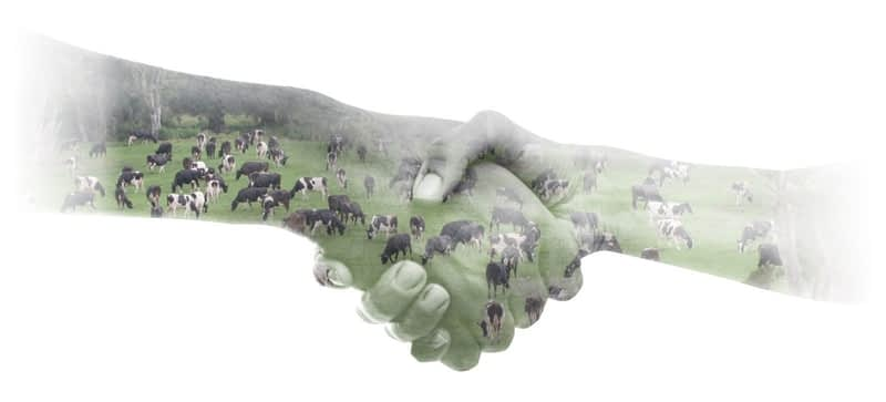Hands shaking with farm overlay