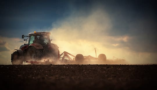 tractor ploughing field for reseeding